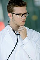 Close_up of a male doctor thinking