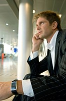 Side profile of a businessman sitting at an airport lounge