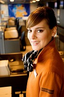 Portrait of a female airline check_in attendant smiling at an airport check_in counter