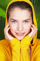 Portrait of young woman wearing hooded sweatshirt