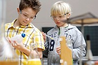 Two boys doing science experiments