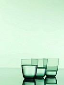 Close_up of three glasses of water
