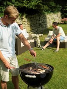 Group of men having barbecue