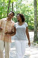 Smiling couple walking together outdoors