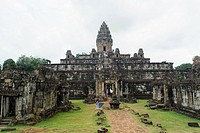 Tourists at old ruins of temple, Bayon Temple, Angkor Wat, Cambodia