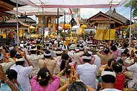Group of native balinese people making religious offering during ceremony, Bali, Indonesia