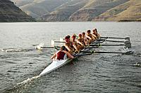 Rowing team practicing in lake