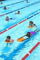 Children swimming in swimming pool