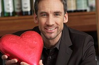 Man holding a chocolate heart