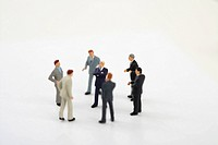 Businessmen figurines standing in a circle