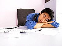 Businessman asleep while talking on telephone
