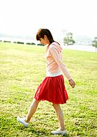 A woman taking a walk in the park