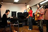 Young woman playing instruments in the recording studio