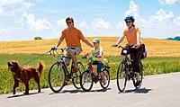 Family on bicycle with dog, Switzerland