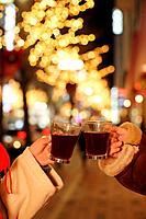 Couple toasting with hot wine