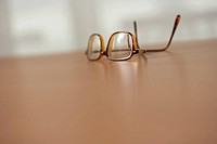 Spectacles on a table