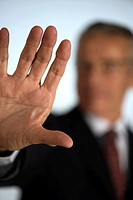 Senior businessman holding hand at camera (thumbnail)