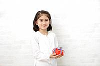 A girl holding a gift box