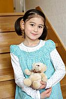 A girl holding a teddy bear