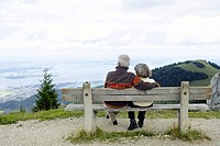 Senior adult couple sitting on a bench