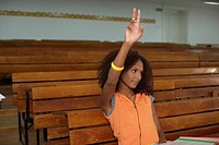 Afro_American woman is lifting up her hand in an auditory, selective focus