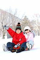 Children at play sledding