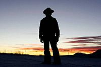 A cowboy searching into the sunset, Shell, Wyoming, Usa