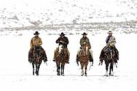 Wranglers out for a ride in winter Shell, Wyoming, Usa