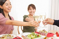 Women enjoying champagne at dinner table