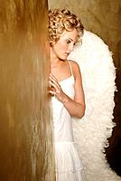Wall, corner, woman, young, blond, angel wings, seriously, thoughtfully,