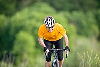 Cyclist riding bicycle, front, view