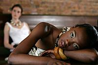 Young African_American woman resting in cafe.