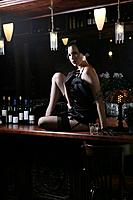 Young sexy woman in burlesque bar (thumbnail)