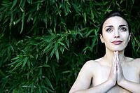 Young topless woman meditating