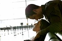 Young affectionate couple in airport