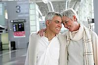 Happy mature couple walking in airport