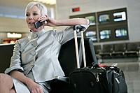 Mature woman on the phone in airport.