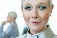 Portrait of mature woman at airport (thumbnail)