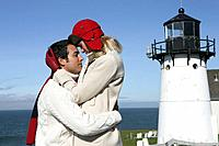 Affectionate couple at lighthouse (thumbnail)