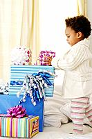 African American child with birthday presents