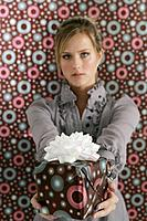 Young woman holding present.