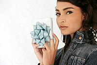 Hispanic woman holding gift (thumbnail)