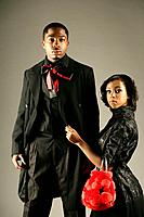 Young stylish African American couple, studio shot (thumbnail)