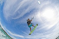 Young woman kite boarding fish eye lens