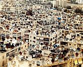 Syria, Aleppo, rooftops of apartment buildings covered with satellite dishes, elevated view
