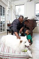 Son 6_7 and father stroking dog