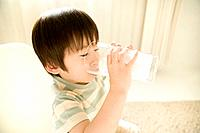 Boy 2_4 drinking glass of milk, elevated view