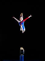 Gymnast 9_10 leaping on balance beam