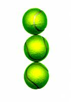 Three tennis balls on white background