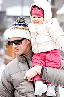 Father carrying baby girl 6_11 months on shoulders, outdoors